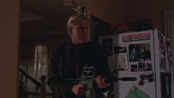 mr joshua gary busey shoots a tv displaying a christmas commercial with his colt xm177 commando at murtaughs home also notice the free south africa - Lethal Weapon Christmas