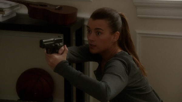 NCIS Special Agent Ziva David holds the SIG on Gibbs and Tony after