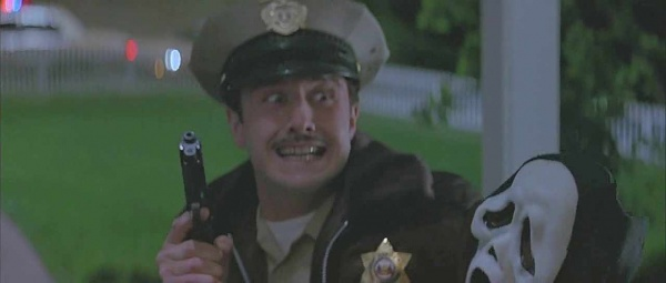 "Deputy Dwight ""Dewey"" Riley (David Arquette) holds the Beretta at the front of the house."