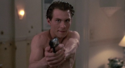 Christian Slater aims a Beretta 92F as George Kuffs in Kuffs (1992).