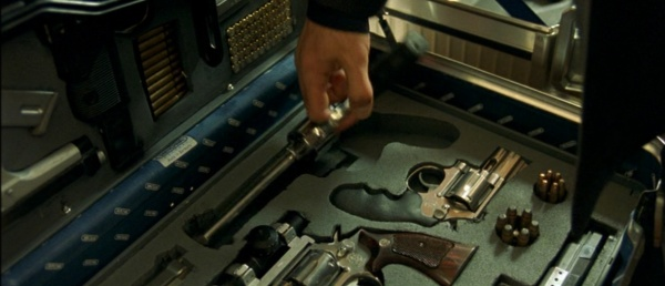 A Snubnose Model 686 Sits Inside Momos Case Next To SW 66 As Hubert Picks Out The Taurus Raging Bull