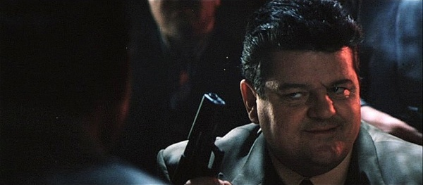 In A Deleted Scene, Valentin Zukovsky (Robbie Coltrane) Holds Up A Glock 17  Pistol. He Correctly Identifies The Weapon As A Glock.