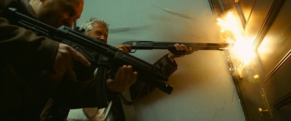 A side view of the agent and his shotgun.